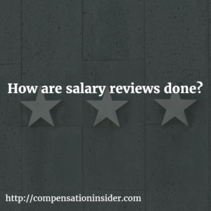 How are salary reviews done ?